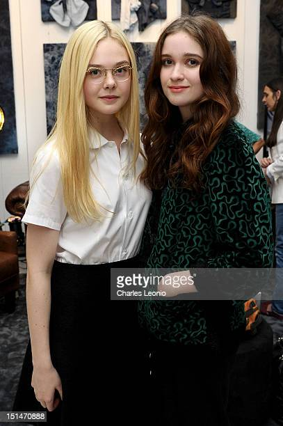 Actresses Elle Fanning and Alice Englert attend the Guess Portrait Studio on Day 2 during the 2012 Toronto International Film Festival at Bell...