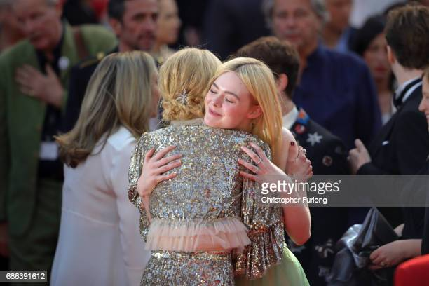 Actresses Elle Fanning and Nicole Kidman embrace after the 'How To Talk To Girls At Parties' screening during the 70th annual Cannes Film Festival at...