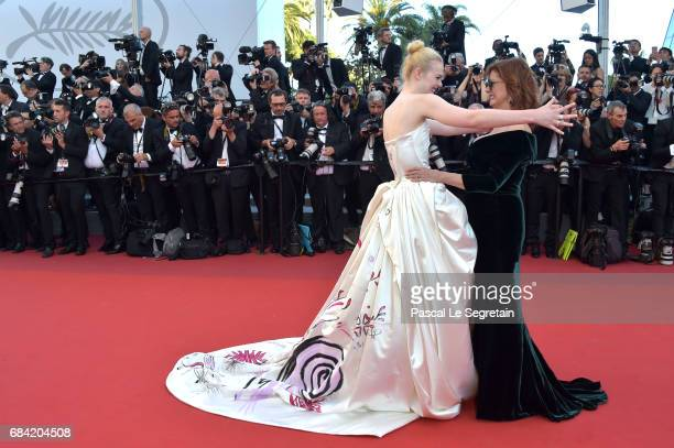 Actresses Elle Fanning and Susan Sarandon attend the Ismael's Ghosts screening and Opening Gala during the 70th annual Cannes Film Festival at Palais...