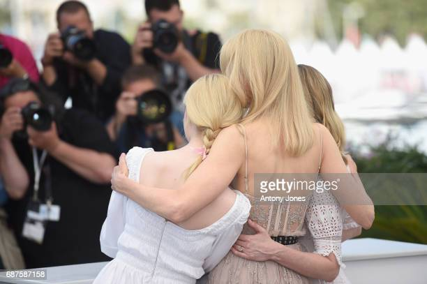 Actresses Elle Fanning Nicole Kidman and Kirsten Dunst attend The Beguiled photocall during the 70th annual Cannes Film Festival at Palais des...