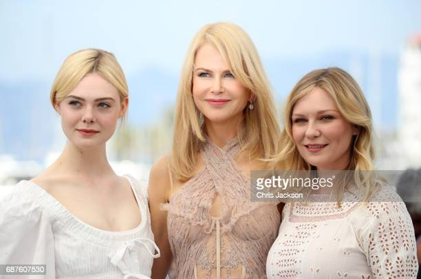 Actresses Elle Fanning Nicole Kidman and Kirsten Dunst attend 'The Beguiled' photocall during the 70th annual Cannes Film Festival at Palais des...