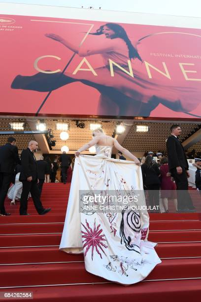 US actresses Elle Fanning poses as she arrives on May 17 2017 for the screening of the film 'Ismael's Ghosts' during the opening ceremony of the 70th...