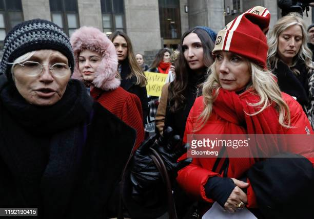Actresses Ellen Barkin from left Rose McGowan Rosanna Arquette second right and Paula Williams right arrive to speak with members of the media after...