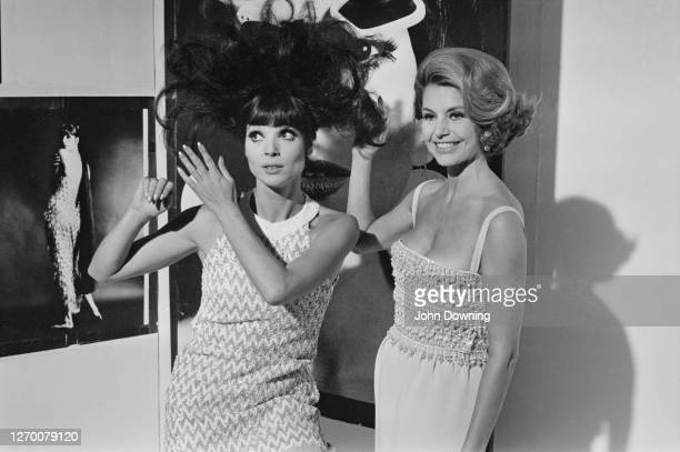 Actresses Elsa Martinelli and Cyd Charisse in an art gallery in Chelsea, London, during the filming of 'Maroc 7', 27th August 1966.