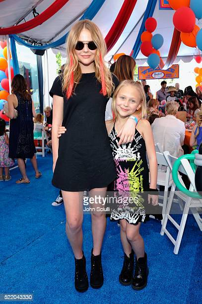 Actresses Emily Alyn Lind and Alyvia Alyn Lind attend the John Varvatos 13th Annual Stuart House benefit presented by Chrysler with Kids' Tent by...