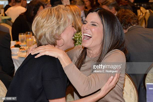 Actresses Emma Thompson and Sandra Bullock attend the 14th annual AFI Awards Luncheon at the Four Seasons Hotel Beverly Hills on January 10 2014 in...