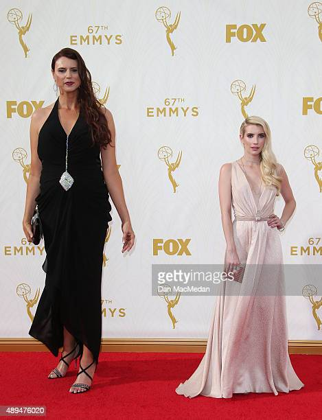Actresses Erika Ervin and Emma Roberts arrive at the 67th Annual Primetime Emmy Awards at the Microsoft Theater on September 20 2015 in Los Angeles...