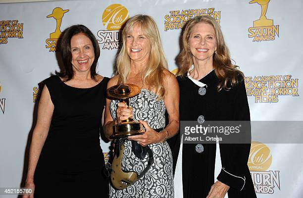 Actresses Erin Gray and Lindsay Wagner present producer Martha De Laurentiis with the Best Actor in a Television Series at the 40th Annual Saturn...