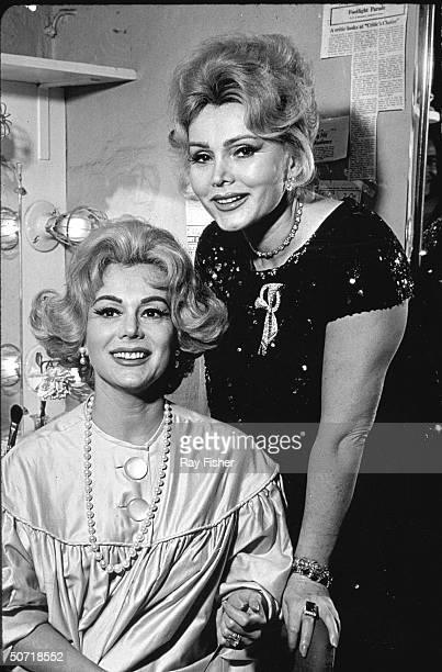 [LR] Actresses Eva Gabor and sister Zsa Zsa during backstage visit by Zsa Zsa to Eva in her dressing room