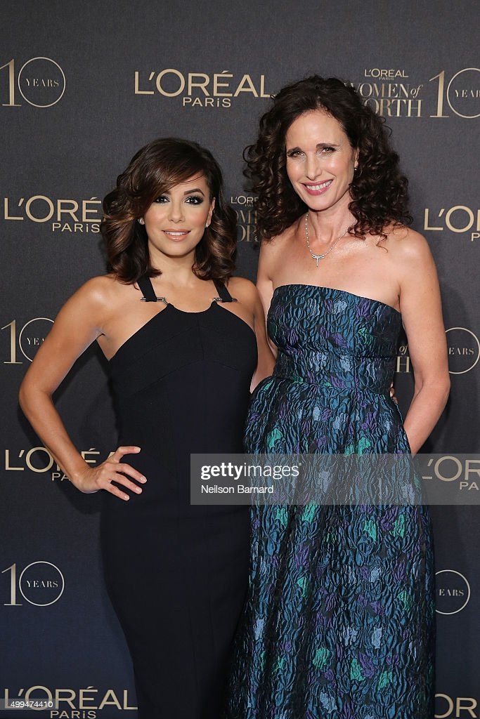 Actresses Eva Longoria (L) and Andie MacDowel attend the L'Oreal Paris Women of Worth 2015 Celebration - Arrivals at The Pierre Hotel on December 1, 2015 in New York City.