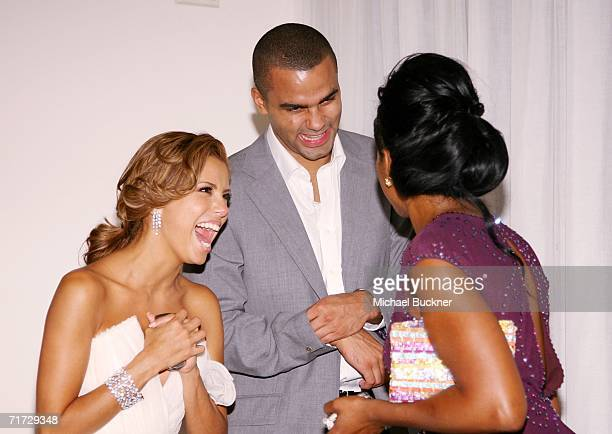 Actresses Eva Longoria, NBA player Tony Parker and Tichina Arnold share a laugh as they leave the 10th Annual Entertainment Tonight Emmy Party...