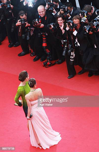 Actresses Evangeline Lilly and Michelle Yeoh attend the You Will Meet A Tall Dark Stranger Premiere at the Palais des Festivals during the 63rd...