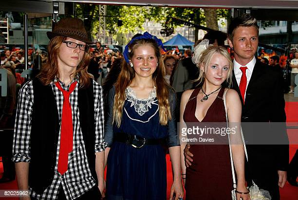 Actresses Evanna Lynch and Jessie Cave and their guests arrive at the European film premiere of 'The Dark Knight' at the Odeon Leicester Square on...