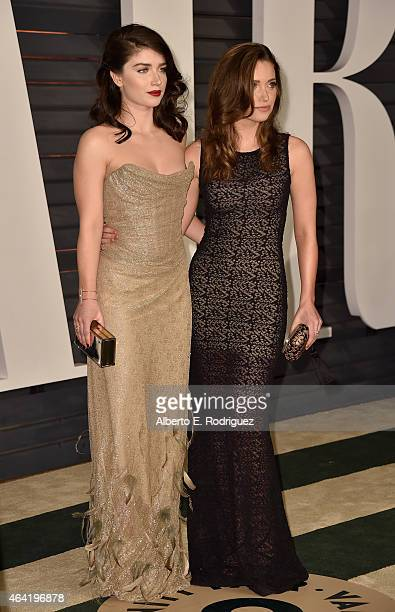 Actresses Eve Hewson and Jordan Hewson attend the 2015 Vanity Fair Oscar Party hosted by Graydon Carter at Wallis Annenberg Center for the Performing...