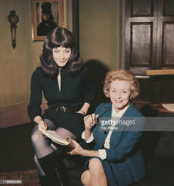 Actresses Evelyn Laye and Linda Thorson reading the script of the new comedy farce 'No Sex Please We're British' UK April 1971
