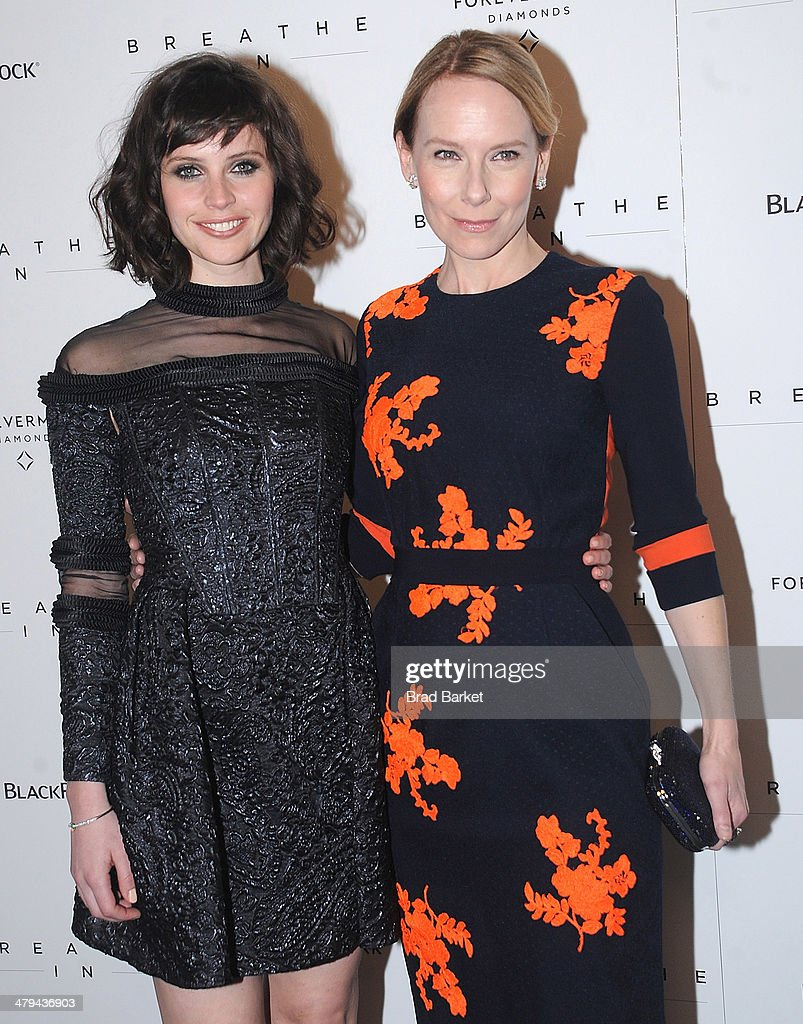 Actresses Felicity Jones (L) and Amy Ryan attend the 'Breathe In' premiere at Sunshine Landmark on March 18, 2014 in New York City.