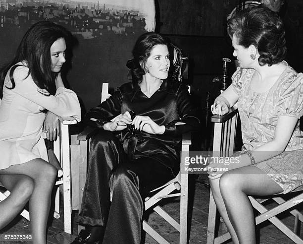 Actresses Francesca Annis Samantha Eggar and Bridget Turner chatting on the set of the film 'The Walking Stick' circa 1969