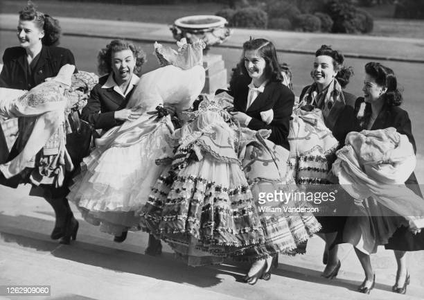Actresses from a theatre in the West End arrive at Alexandra Palace in London with their costumes for the postwar restart of television broadcasting...