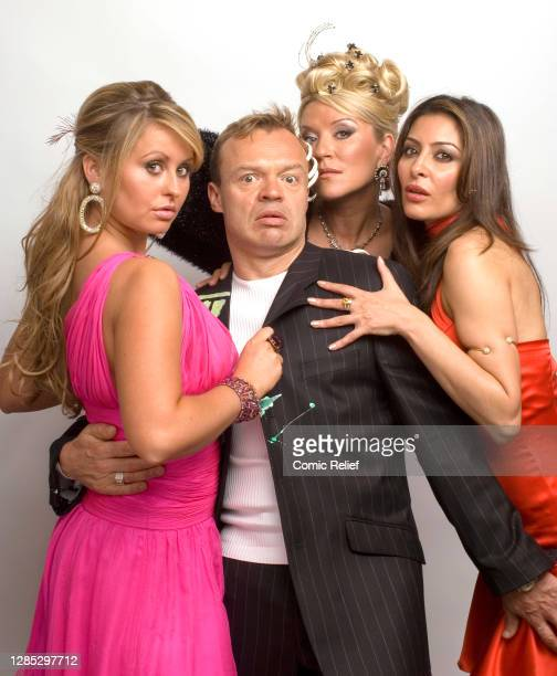Actresses from 'Footballers Wives' pose in the studio with comedian, Graham Norton who is guest starring in a special episode of 'Footballers' wives'...