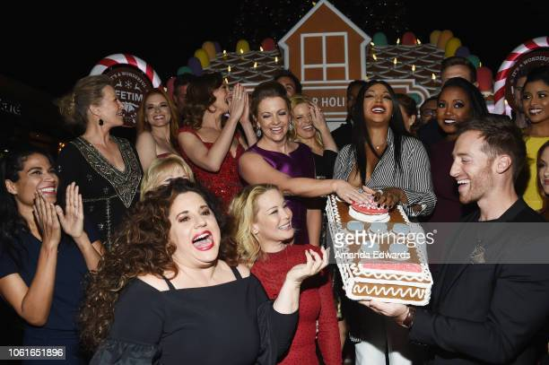 Actresses from Lifetime's Christmas Movies attend the opening night celebration of the Life-Sized Gingerbread House Experience at The Grove on...