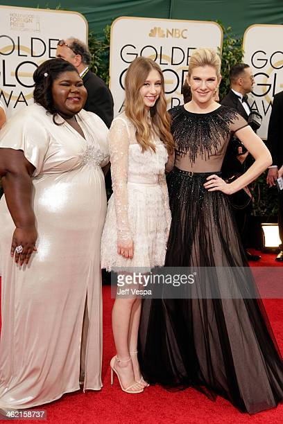 Actresses Gabourey Sidibe Taissa Farmiga and Lily Rabe attend the 71st Annual Golden Globe Awards held at The Beverly Hilton Hotel on January 12 2014...