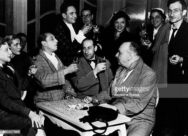 Actresses Gabrielle Dorziat Monique Melinand Louis Jouvet's companion and the actors Leo Lapara Helena Bossis Pierre Dux and Jean Renoir at the...
