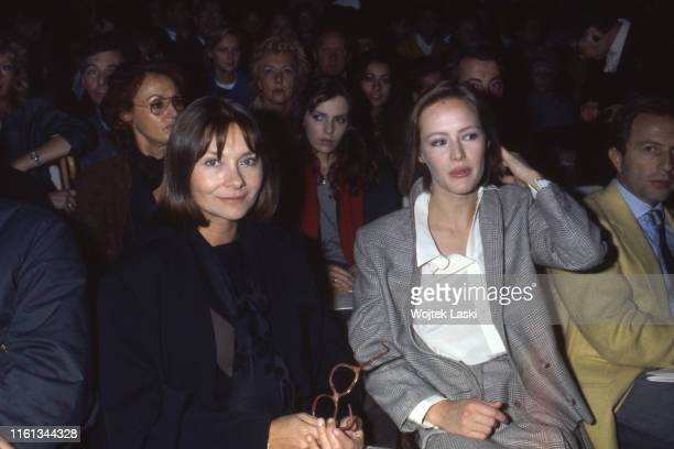 Gabrielle Lazure and Macha Meril in the audience during the Nino Cerruti fashion show Paris France on October 20th 1983