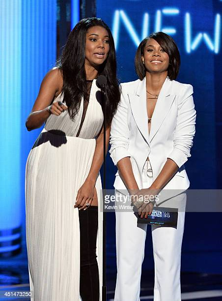 Actresses Gabrielle Union and Regina Hall speak onstage during the BET AWARDS '14 at Nokia Theatre LA LIVE on June 29 2014 in Los Angeles California