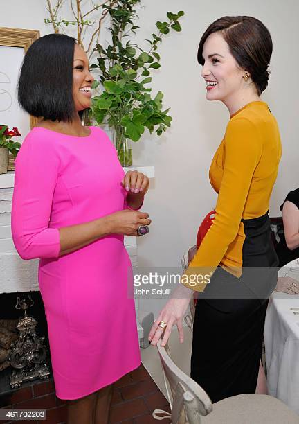 Actresses Garcelle Beauvais and Michelle Dockery attend LOVEGOLD Luncheon celebrating Michelle Dockery at Chateau Marmont on January 9 2014 in Los...