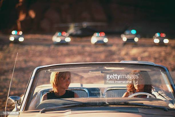 Actresses Geena Davis and Susan Sarandon weigh up their options in the film 'Thelma And Louise' 1991