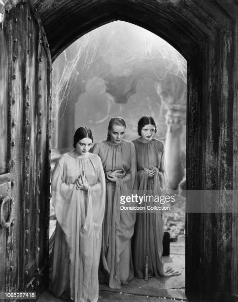 Actresses Geraldine Dvorak, Dorothy Tree, and Cornelia Thaw as the brides of Dracula in a scene from 'Dracula', directed by Todd Browning, 1931.