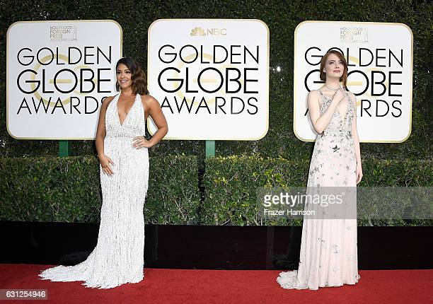 Actresses Gina Rodriguez and Emma Stone attend the 74th Annual Golden Globe Awards at The Beverly Hilton Hotel on January 8 2017 in Beverly Hills...