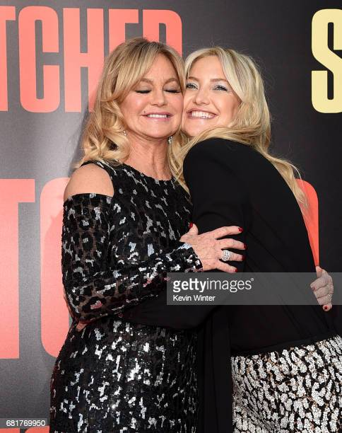 "Actresses Goldie Hawn and her daughter Kate Hudson arrive at the premiere of 20th Century Fox's ""Snatched"" at the Village Theatre on May 10, 2017 in..."