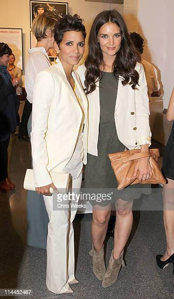 Actresses Halle Berry and Katie Holmes attend the opening of 'Beauty Culture' at the Annenberg Space For Photography on May 19 2011 in Century City...