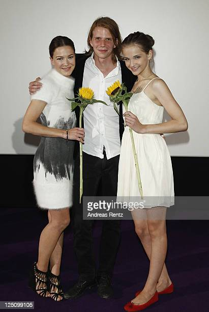 Actresses Hannah Herzsprung and Lisa Vicari with director Tim Fehlbaum attend 'Hell' German premiere on September 15 2011 in Berlin Germany
