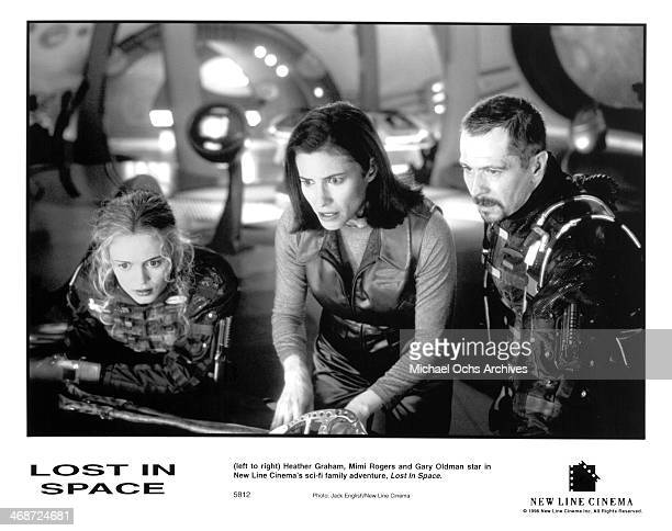 Actresses Heather Graham Mimi Rogers and actor Gary Oldman on set of the New Line Cinema movie ' Lost in Space ' circa 1998