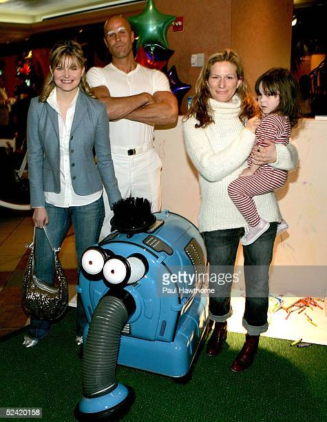 Actresses Heather Tom and Ana Gasteyer with her daughter Frances McKittrick pose with Mr Clean and Noonoo as they attend the 'Teletubbies' Movie...