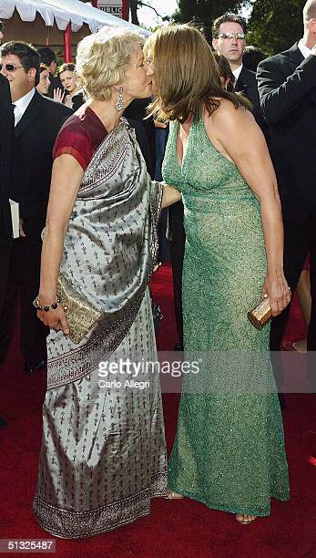 Actresses Helen Mirren and Lorraine Bracco attend the 56th Annual Primetime Emmy Awards at the Shrine Auditorium September 19 2004 in Los Angeles...