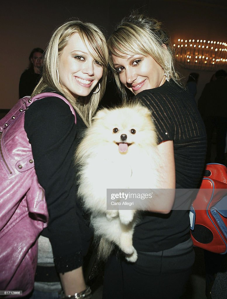 Actresses Hilary Duff (L) and Haylie Duff (R) pose for a photo during the GW Little Pet Fashion Show at the Century Plaza Hotel November 9, 2004 in Los Angeles, California.