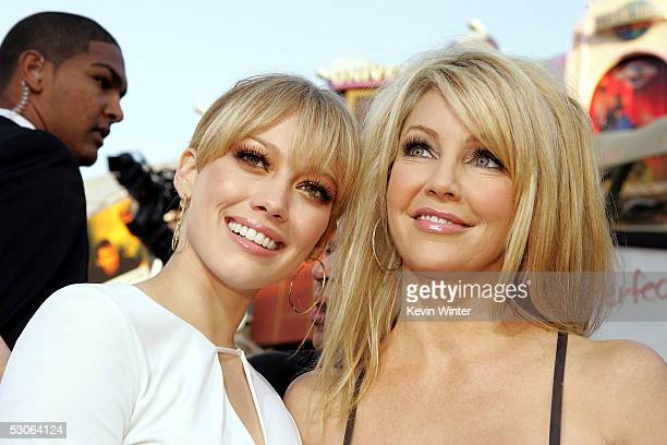 Actresses Hilary Duff and Heather Locklear arrive at the premiere of The Perfect Man at Universal Studios Cinema on June 13 2005 in Hollywood...