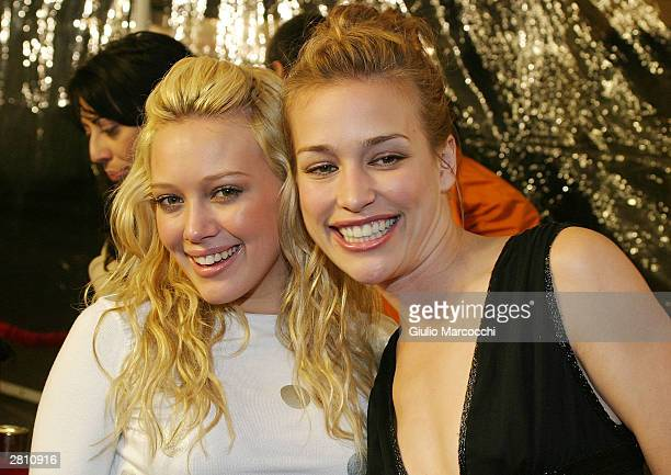 Actresses Hilary Duff and Piper Perabo attend the Cheaper By The Dozen Premiere December 14, 2003 in Hollywood, California.