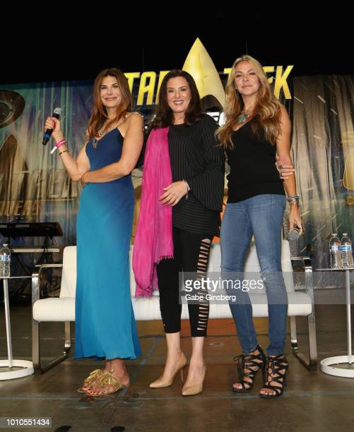 Actresses Hilary Shepard Bertila Damas and actress and dancer Cyia Batten pose at the Guest Stars of DS9 panel during the 17th annual official Star...