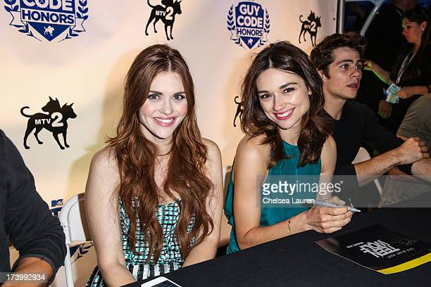 Actresses Holland Roden and Crystal Reed attend MTV2 Party in The Park at Comiccon International 2013 at PETCO Park on July 18 2013 in San Diego...