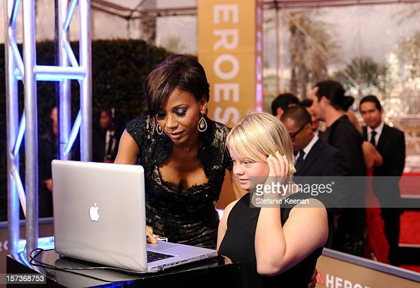 Actresses Holly Robinson Peete and Lauren Potter attend the CNN Heroes An All Star Tribute at The Shrine Auditorium on December 2 2012 in Los Angeles...