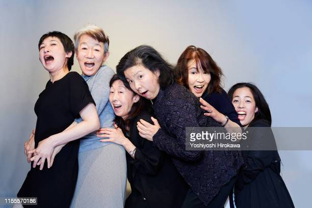 Actresses Hugging on Stage