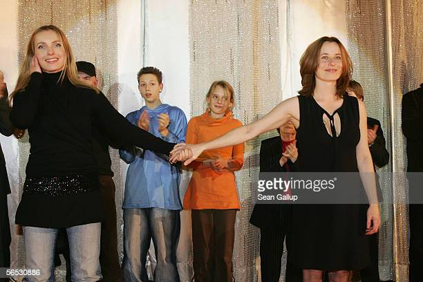 Actresses Inka Friedrich aand Nadja Uhl receive applause at the conclusion of the premiere of the new German comedy film Sommer vorm Balcon January 5...