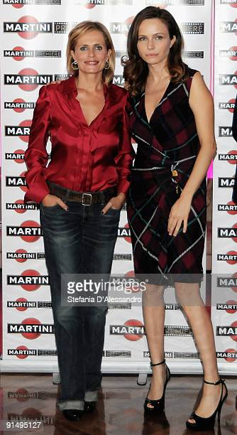 Actresses Isabella Ferrari and Francesca Neri attend the Martini Premiere Award Photocall at the Terrazza Martini on October 6 2009 in Milan Italy