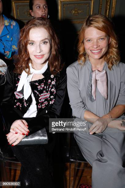Actresses Isabelle Huppert and Melanie Thierry attends the Giorgio Armani Prive Haute Couture Fall Winter 2018/2019 show as part of Paris Fashion...