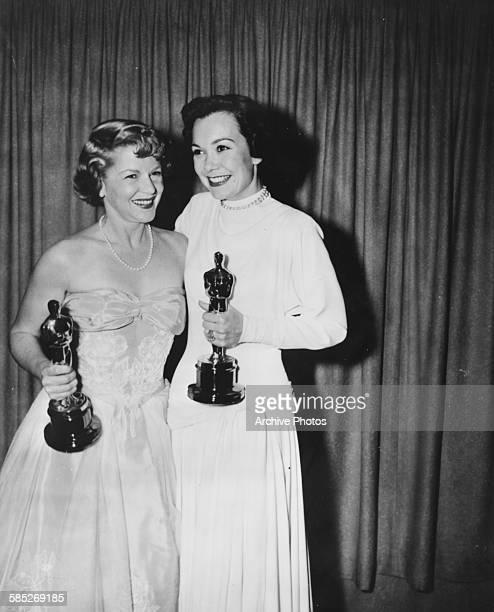 Actresses Jane Wyman and Claire Trevor holding their Oscars at the 21st Academy Awards Los Angeles March 24th 1949