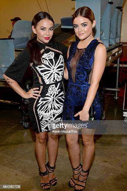 Actresses Janel Parrish and Lucy Hale attend the Teen Choice Awards 2015 at the USC Galen Center on August 16 2015 in Los Angeles California